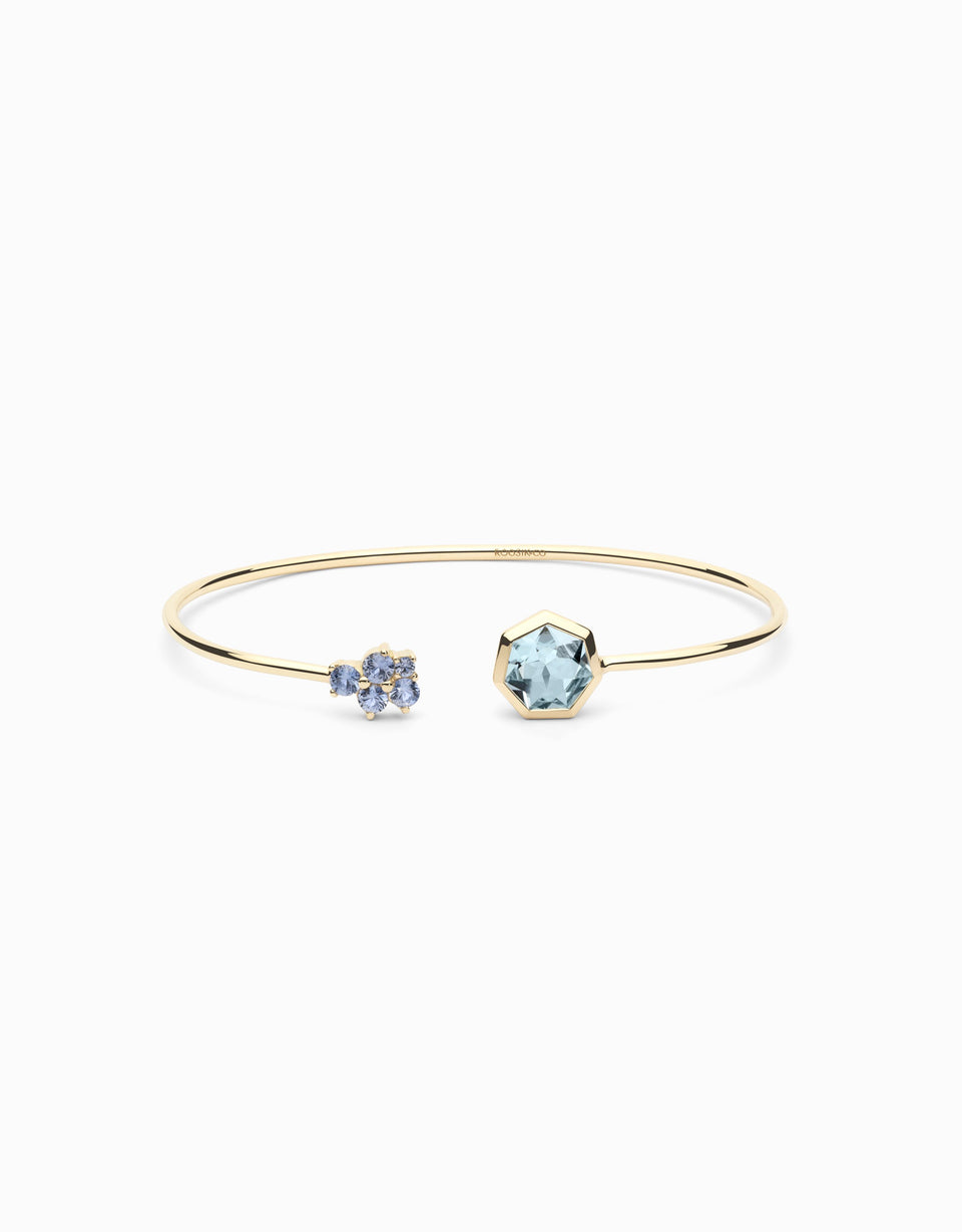 Gold Bangle with sapphires and heptagonal topaz