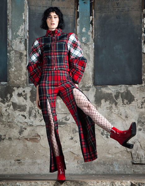 A modern version of the punk revolution.  Using different colored tartan materials and clashing them together.  This piece has a very unique and beautiful shape.
