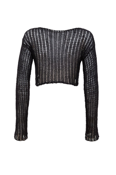 This piece is handmade in Germany from a beautiful mixture of natural fabrics including Nettle.  A cropped length longsleeve top which is slightly seethrough.  With its seethrough knitted structure it reminds us of a spiderweb.