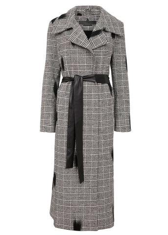 Dark Rise Coat is an vegan oversized elongated Coat with a houndstooth fabric and a pleather belt.