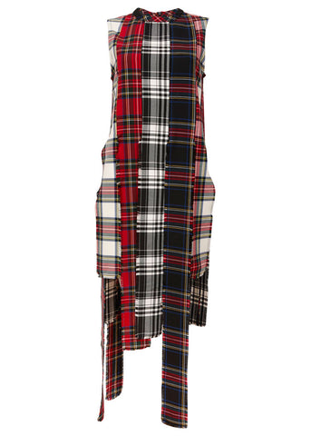A modern vegan version of the punk revolution.  Using different colored tartan materials and clashing them together.  This piece can be worn as a top or a very short dress.