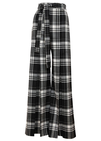 A tight high waisted pant with very wide legs including a pleat detail at front. A modern vegan version of the punk revolution.