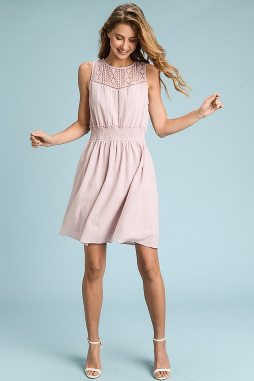 Lilac sleeveless dress with lace yoke detail and a smocked waistline
