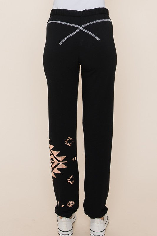 Jet Black French terry rollover joggers with rose gold tribal print