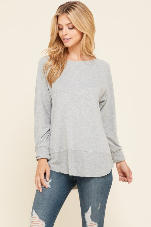 Heather Grey pullover knit tunic top in a relaxed fit, with fold over long sleeves and detailed ribbing around the lower hemline, raw edges.