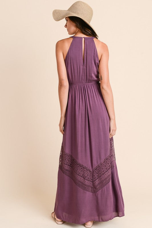 Eggplant maxi dress with crochet trim, stretchable elastic waist, keyhole closure around the neck. Fully Lined.