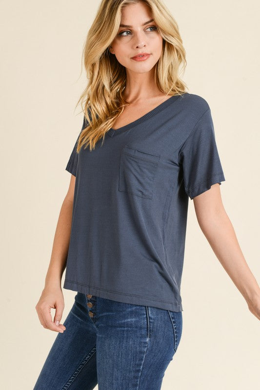 SOLID MODAL KNIT TOP WITH LAYERED RIBBED V NECKLINE DETAIL AND SLIGHT SHOULDER DROP WITH A DRAPED FRONT POCKET AT CHEST