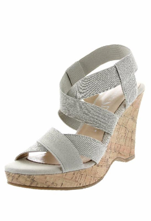Expandable, stretchy, criss cross wedges with heel are comfortable and great looking.