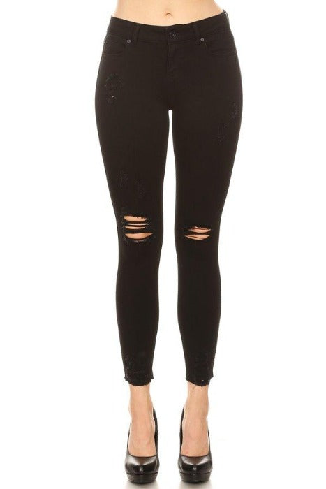 Distressed Black Mid Rise Skinny Jeans with Chewed Hems.
