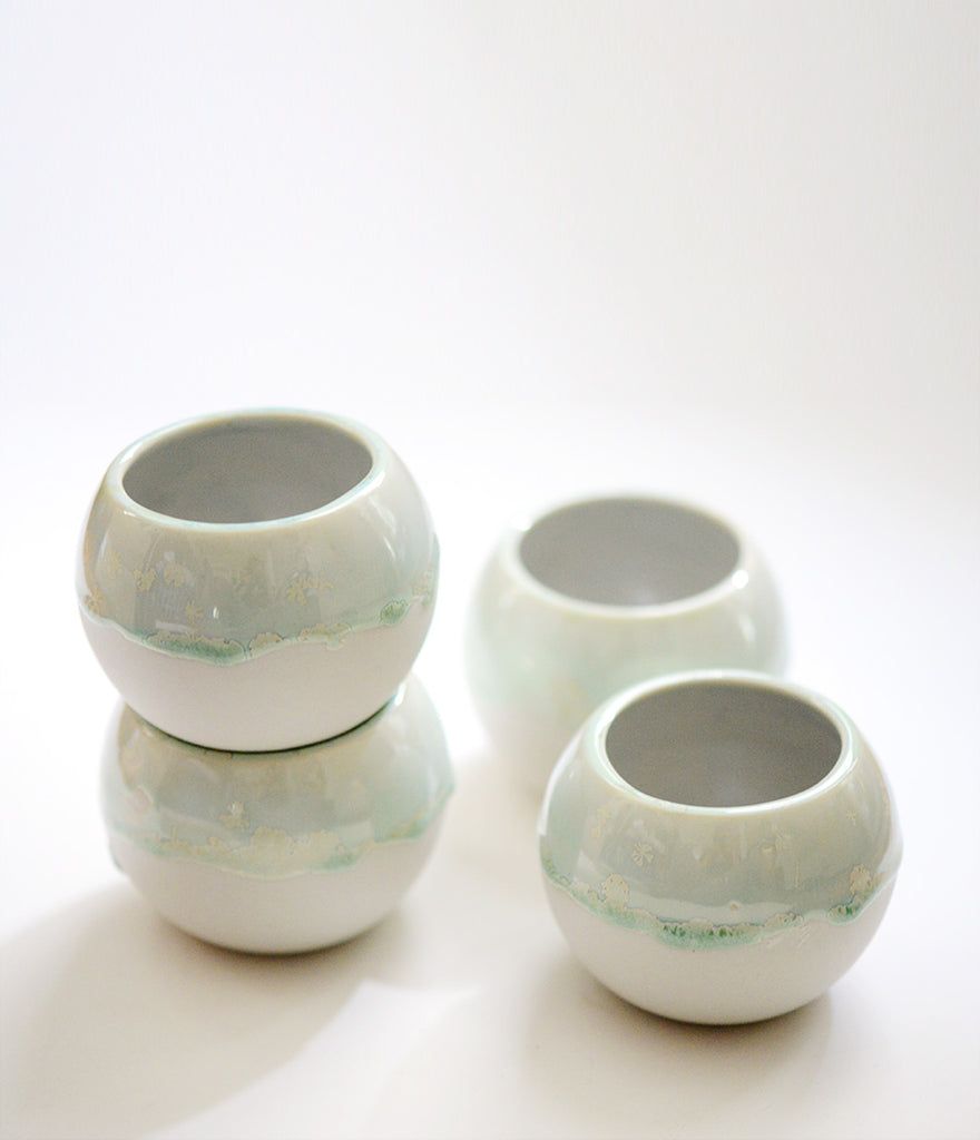 porcelain buoy vessels, porcelain crystalline glaze, drippy glaze on porcelain, porcelain and stone