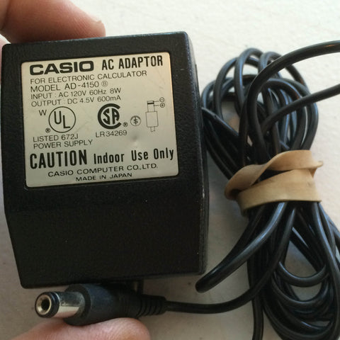 Casio Calculator AD-4150 DC 4.5V 600mA Power Supply AC/DC Adapter Wall Wart