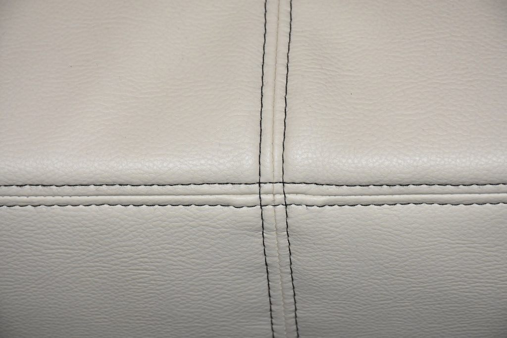 cleaning a white leather sofa