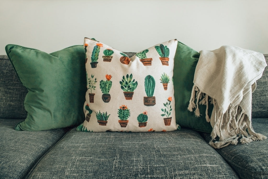 what cushions go with a green sofa