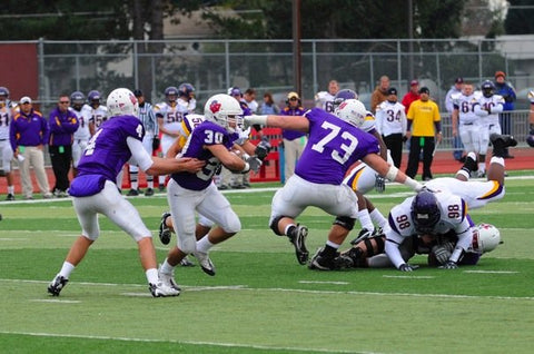 Aaron playing football at Linfield University