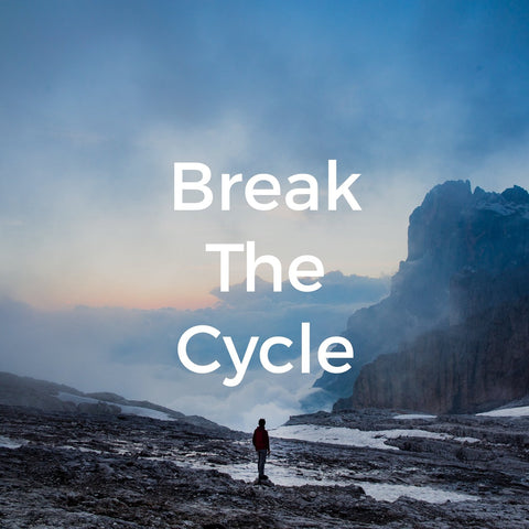 A man walking in the wilderness with the caption 'Break the Cycle'.