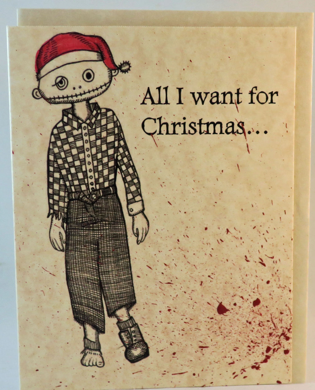 zombie christmas card with brains and festive blood splatter