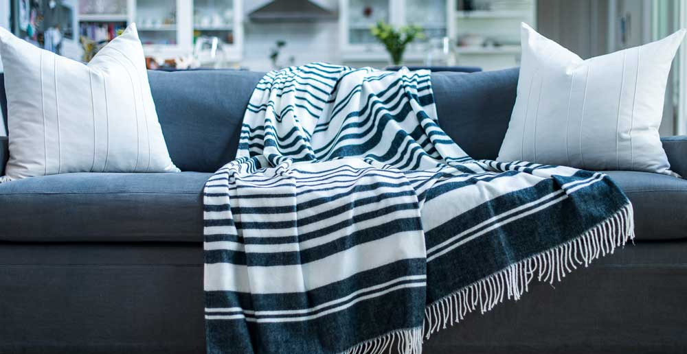Xhosa stripe African blanket lying on a couch