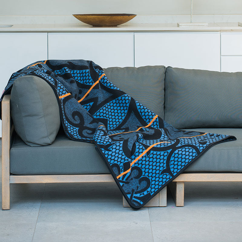 SeanaMarena basotho blanket and throw laying on a couch