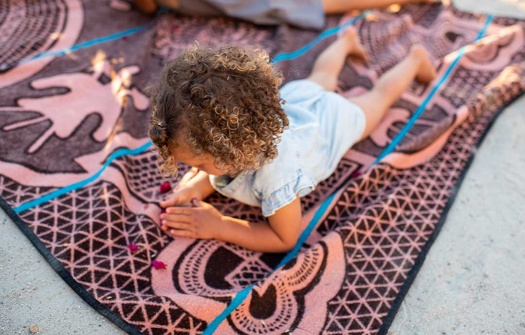 Basotho Heritage African Blanket with young child on a beach