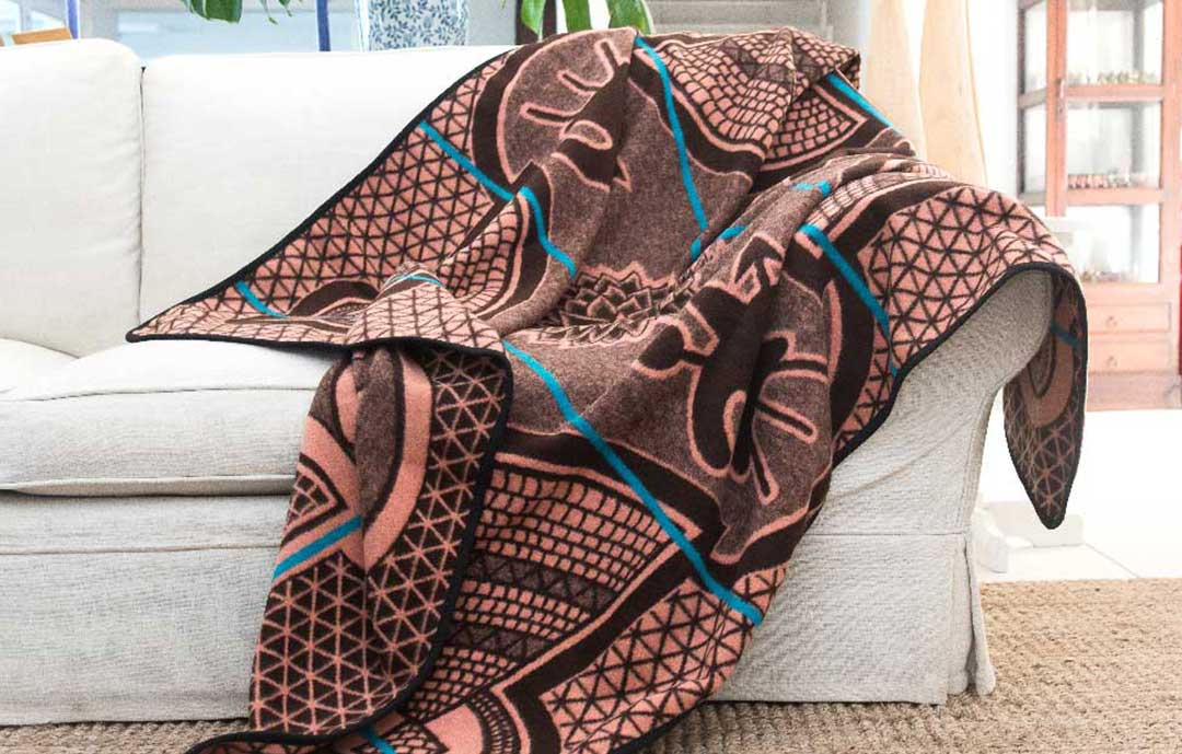The Ultimate guide to the Basotho Heritage Blanket  basotho heritage blanket over couch