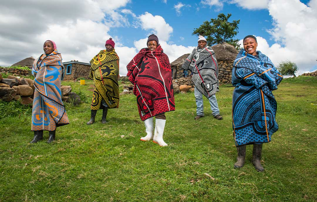 The Ultimate- guide to the Basotho Heritage Blanket lesotho men and women wrapped in basotho heritage blanket