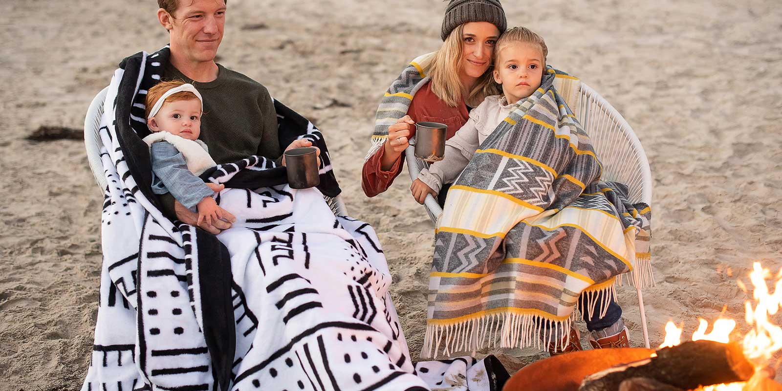 Thula tula camping blanket on beach with couple and kidws