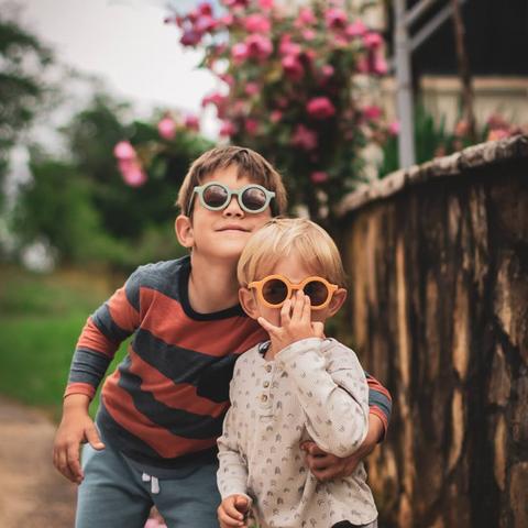 Little boys wearing greco and co sunglasses in the autumn weather to protect their eyes