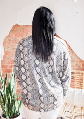 Snake Knit V Neck Top