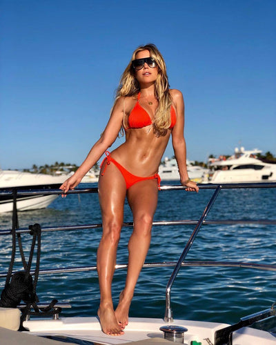 Sylvie Meis Golden Hour #boatday❤️ #miami wearing @sylviedesigns #bikini