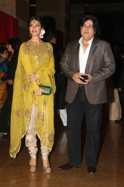 Bollywood actress Jacqueline Fernandez wore maangtika and hoops to match with her suit at Riteish and Genelia's wedding