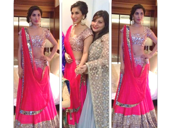 Artist Sophie Chaudhary wore golden hoop danglers to match with her pink lehenga at Bollywood actress Dia Mirza's wedding