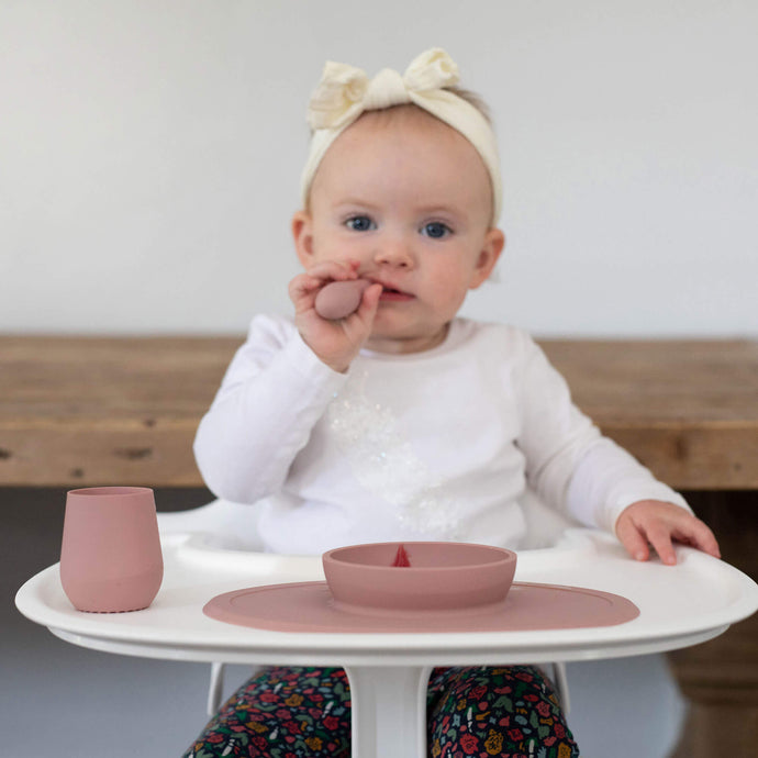 What are the developmental milestones for feeding?