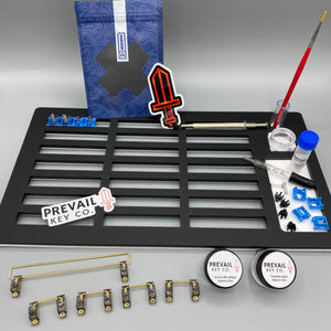 This is a switch modding beginners kit from prevail key co. Products shown are monstargear lube station, deskeys switch films, durock stabilziers, lube brush, krytox and tribosys lubricants.
