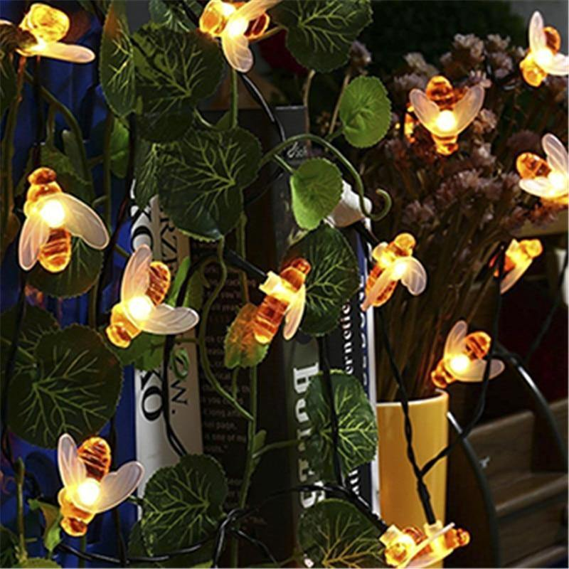 solar powered honey bee string lights at night