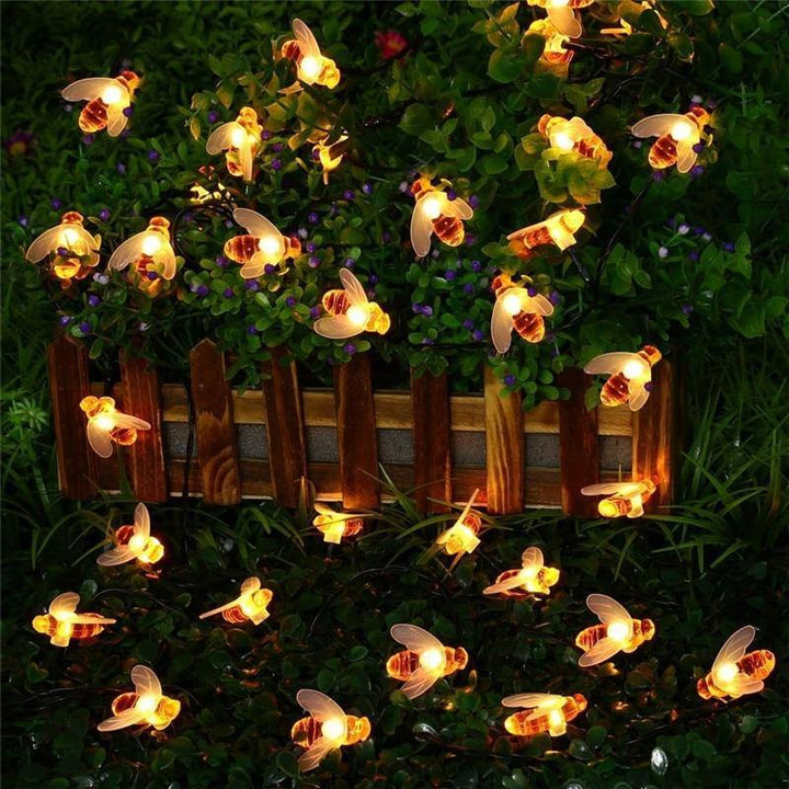solar powered string lights with honey bees
