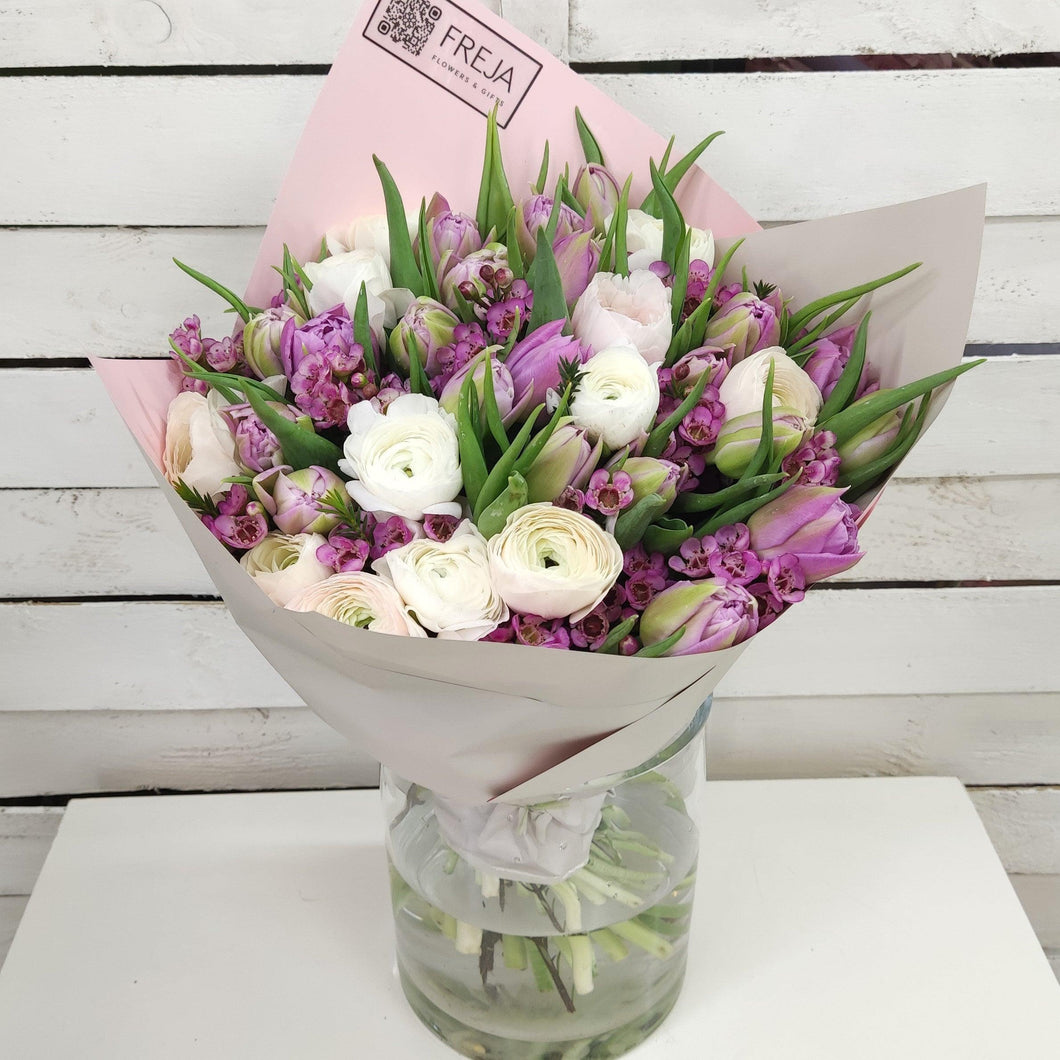 Purple tulips and ranunculus