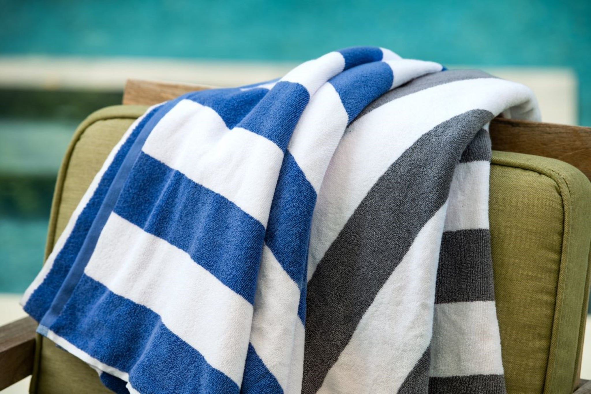 Thomaston Mills American Luxury Breeze Pool Towels laid over a chair.