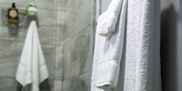 TM Plush By Thomaston Mills towels hanging in a bathroom.