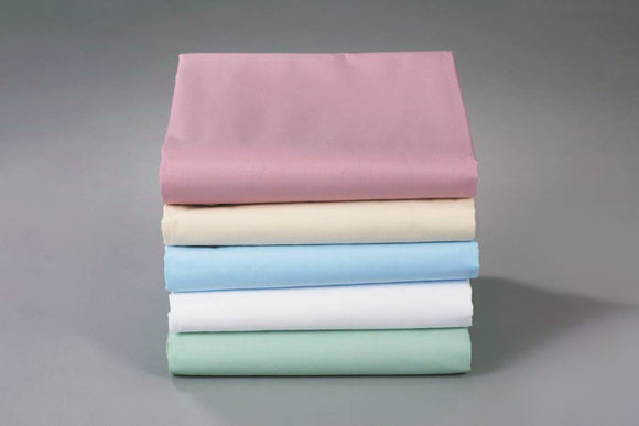 Thomaston Mills Pastel Sheets in Bone, Light Blue, Seafoam Green and Rose folded and stacked.