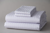 Thomaston Mills T-310 Satin Stripe Sheets and Pillowcases folded and stacked.