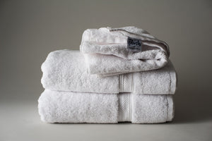 White TM Plush by Thomaston Mills towels folded and stacked.