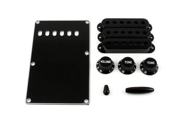 Accessory kit for Strat - 1 spring cover, 3 p/up covers, 1 vol & 2 tone knobs, 1 switch tip, 1 trem arm tip