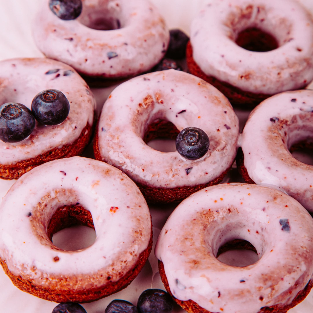 Oven-baked donuts with blueberry glaze