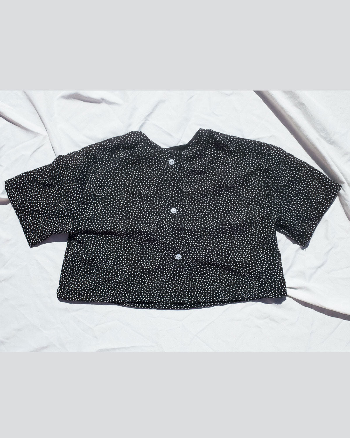polka dots button front top shirt  and 3/4 sleeves.