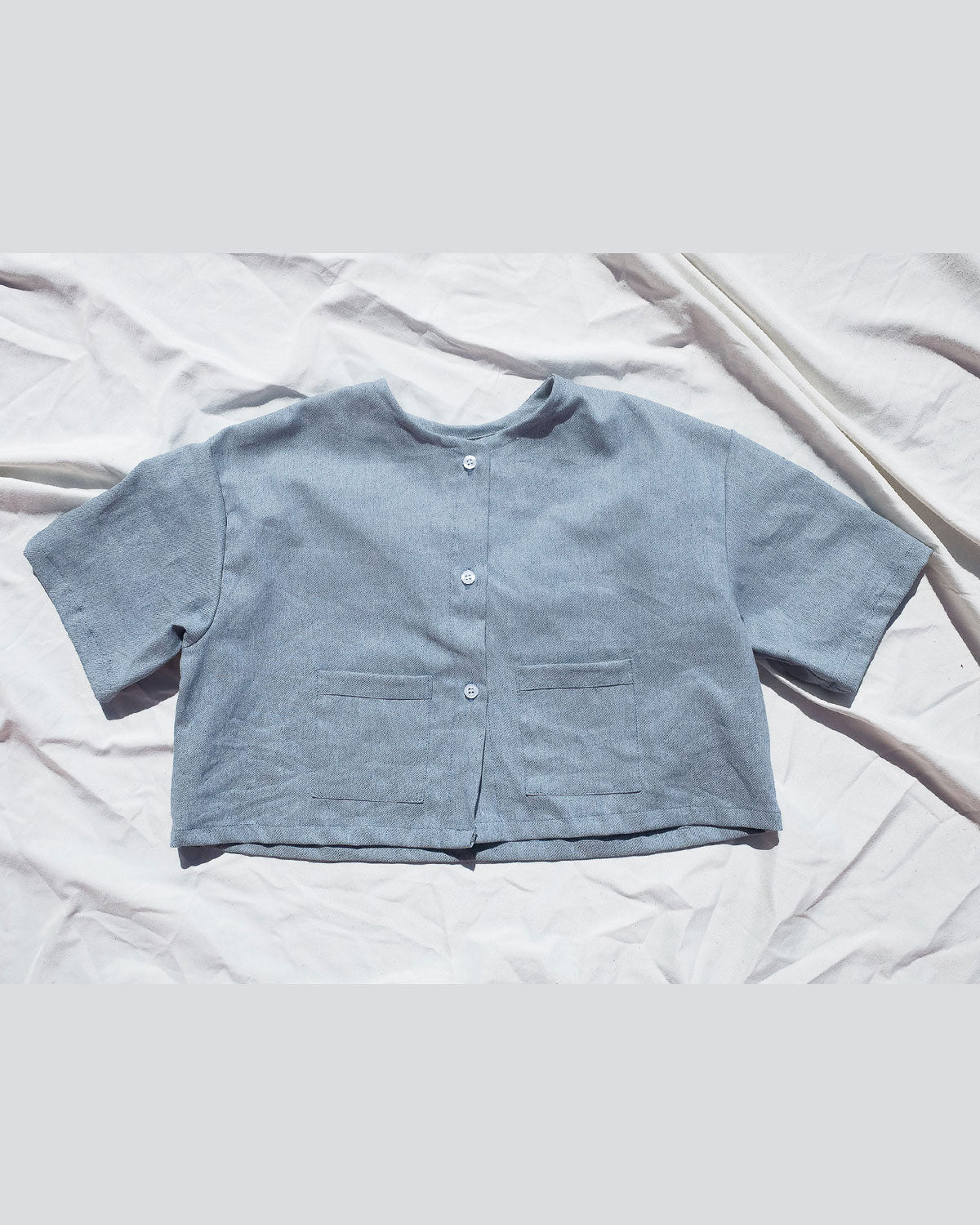 Gender neutral shirt for toddlers and kids. Premium Upcycled Denim Button Up Top with Denim Pockets