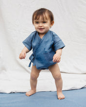 Load image into Gallery viewer, Premium Upcycled Denim Pocket Kimono Onesie for babies with a pocket detail.