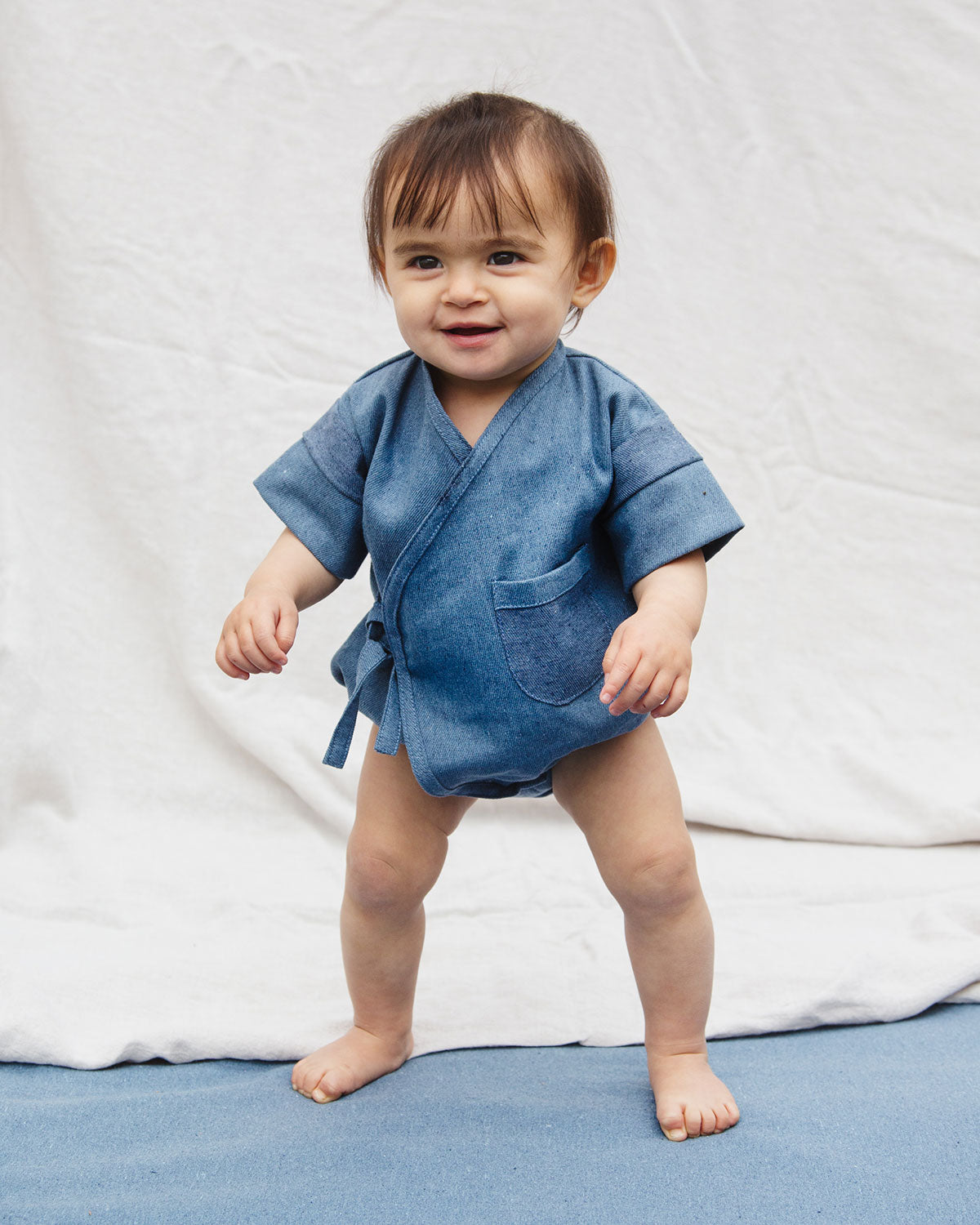 Premium Upcycled Denim Pocket Kimono Onesie for babies with a pocket detail.