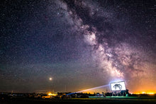 Load image into Gallery viewer, Clearwater Drive-In at Kyle Saskatchewan, under the Milky Way, showing Jurrasic World