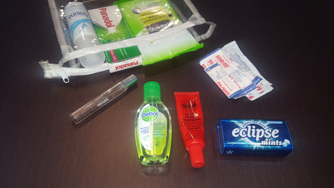 emergency bag, wipes, hand sanitizer, paw paw, mint , perfume ,deodorant