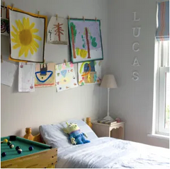 Put your kids artwork to attention by hanging them on to the wall